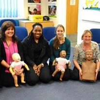 Danielle with group of ladies and CPR dummies