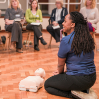 ABC Life Support founder Danielle Bridge teaching CPR to a group of delegates