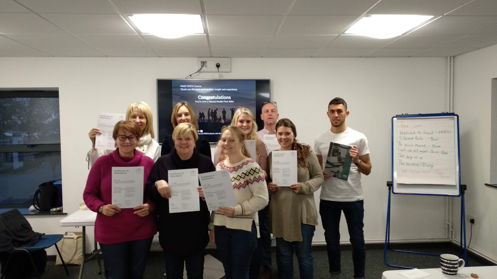 A group of Mental Health First Aid course delegates with their certificates