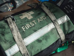 Dirty green canvas first aid kit