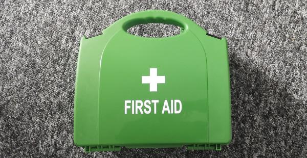 Green plastic first aid kit